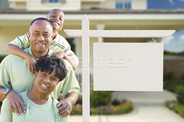 African American Family In Front of Blank Real Estate Sign and House Stock photo © feverpitch