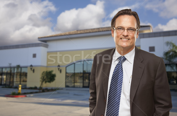 Businessman In Front of Vacant Office Building. Stock photo © feverpitch