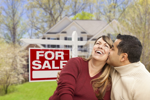Couple in Front of For Sale Sign and House Stock photo © feverpitch