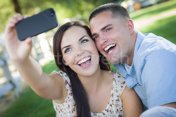 Mixed Race Couple Taking Self Portrait in Park Stock photo © feverpitch
