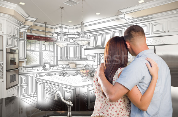 Young Military Couple Inside Custom Kitchen and Design Drawing C Stock photo © feverpitch