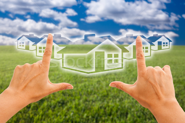 Female Hands Framing Houses Over Grass and Sky Stock photo © feverpitch