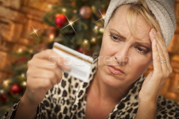 Upset Woman Holding Credit Card In Front of Christmas Tree Stock photo © feverpitch