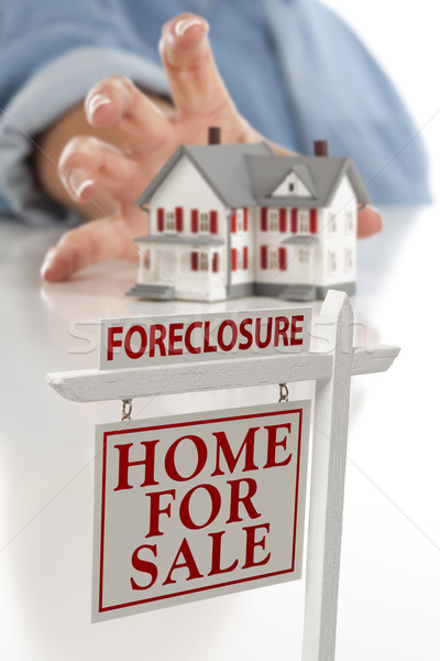 Foreclosure Sign in Front of Woman Reaching for House Stock photo © feverpitch