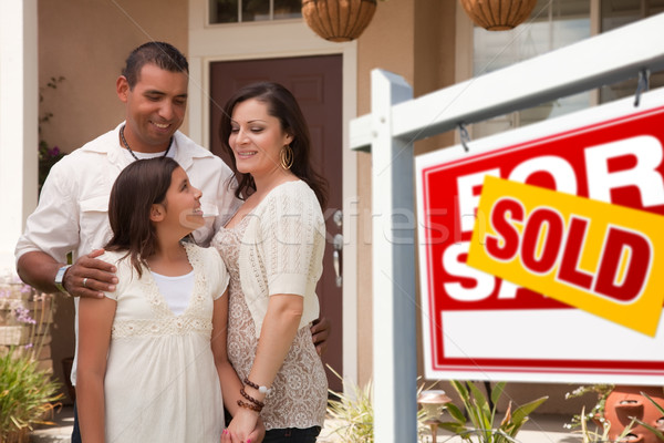 Hispanic Family in Front of Their New Home with Sold Sign Stock photo © feverpitch