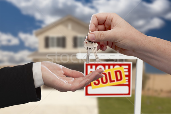 Handing Over the House Keys in Front of Sold New Home Stock photo © feverpitch