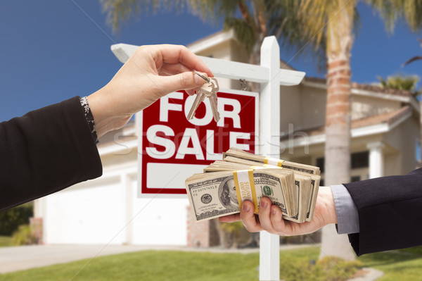 Agent Handing Over Keys, Buyer Handing Over Cash for House Stock photo © feverpitch