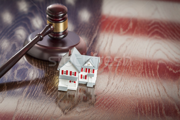 Small House and Gavel on Table with American Flag Reflection Stock photo © feverpitch