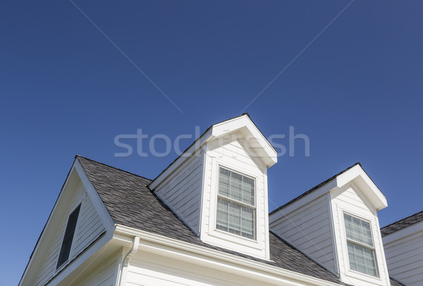 Roof of House and Windows Against Deep Blue Sky Stock photo © feverpitch