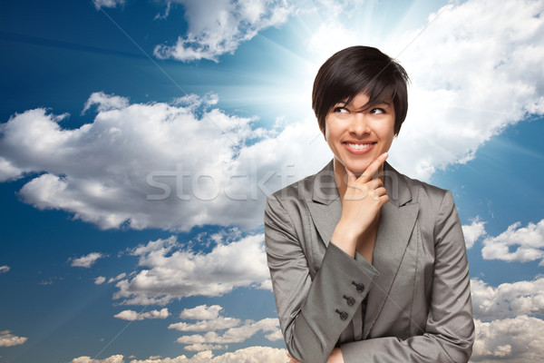 Pretty Multiethnic Young Adult Woman Over Clouds Stock photo © feverpitch
