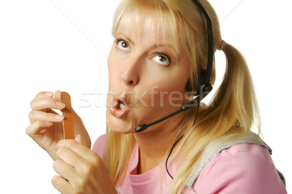 An obviously bored customer support girl. Stock photo © feverpitch