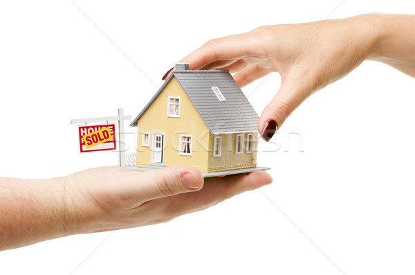 Reaching For A Home with Sold Real Estate Sign Stock photo © feverpitch