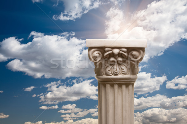 Ancient Replica Column Pillar Over Clouds and Sun Stock photo © feverpitch