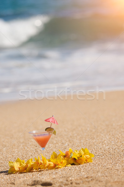 Tropical Drink on Beach Shoreline Stock photo © feverpitch