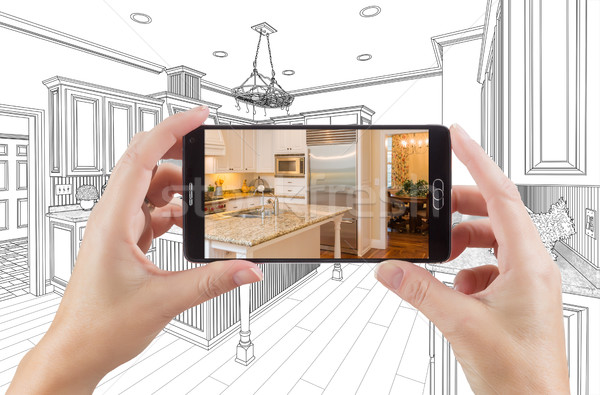 Hands Holding Smart Phone Displaying Photo of Kitchen Drawing Be Stock photo © feverpitch
