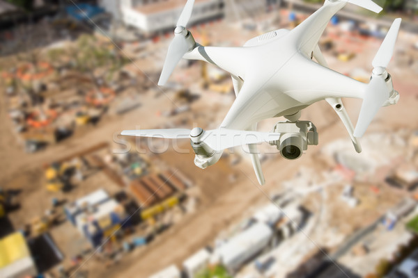 Unmanned Aircraft System (UAV) Quadcopter Drone In The Air Over  Stock photo © feverpitch