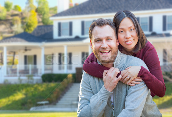 Mixed Race Caucasian and Chinese Couple In Front Yard of Beautif Stock photo © feverpitch