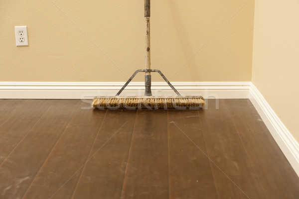 Push Broom on a Newly Installed Laminate Floor and Baseboard Stock photo © feverpitch