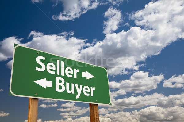 Seller, Buyer Green Road Sign Over Clouds Stock photo © feverpitch