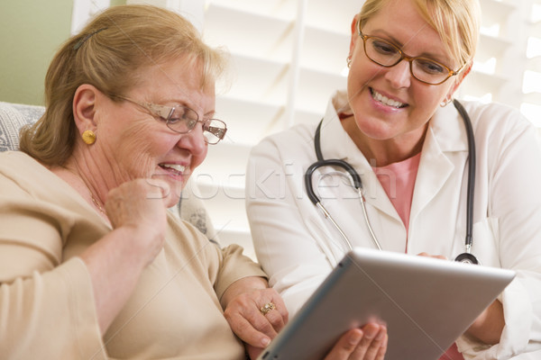 Doctor or Nurse Talking to Senior Woman with Touch Pad Stock photo © feverpitch