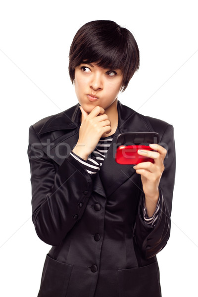 Pensive Young Mixed Race Woman with Cell Phone on White Stock photo © feverpitch