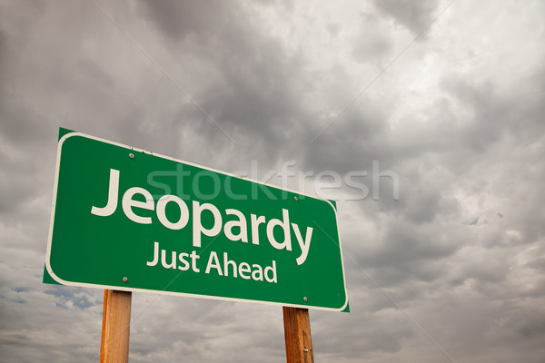 Jeopardy Green Road Sign Over Storm Clouds Stock photo © feverpitch