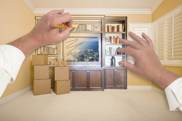 Hands Drawing Entertainment Unit In Room With Moving Boxes Stock photo © feverpitch