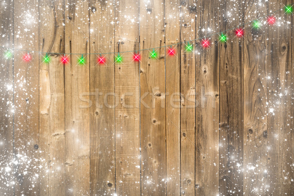 Wooden Background with Christmas Lights and Snowy Border Stock photo © feverpitch