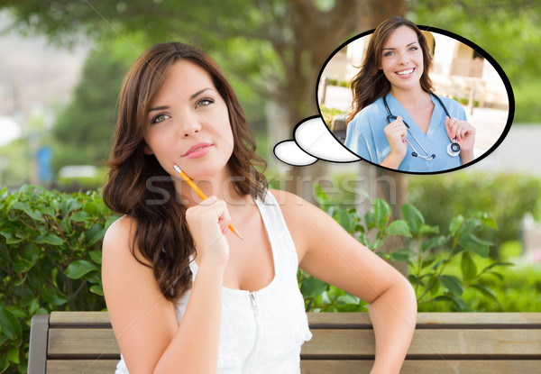 Thoughtful Young Woman with Herself as a Doctor or Nurse Inside  Stock photo © feverpitch