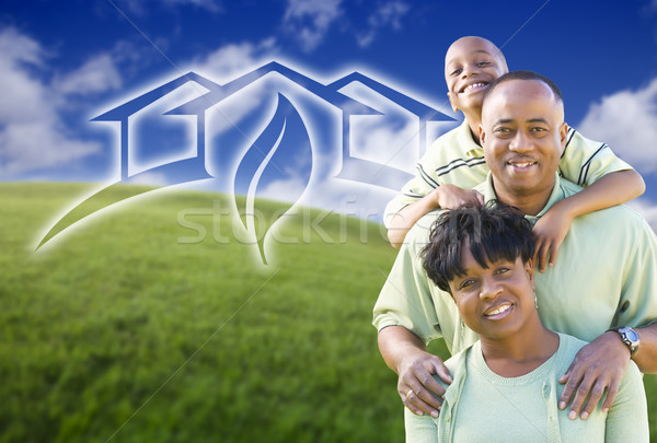 Happy African American Family and Green House Graphic in Field Stock photo © feverpitch