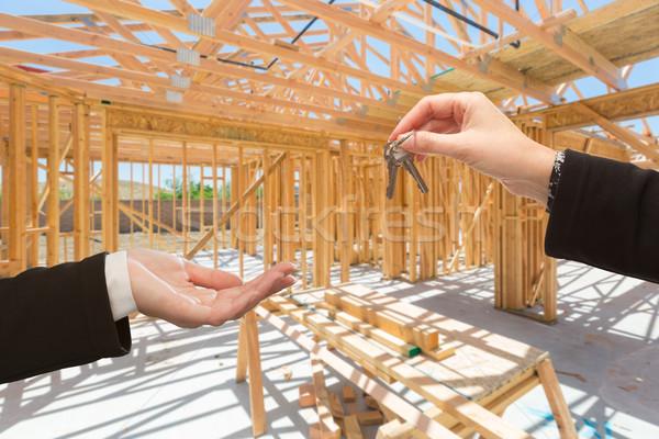 Handing Over The Keys On Site Inside New Home Construction Frami Stock photo © feverpitch