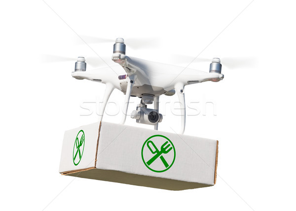 Unmanned Aircraft System (UAV) Quadcopter Drone Carrying Package Stock photo © feverpitch