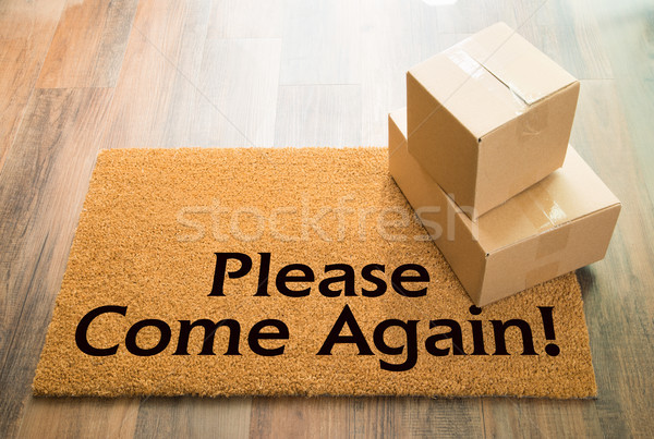Please Come Again Welcome Mat On Wood Floor With Shipment of Box Stock photo © feverpitch