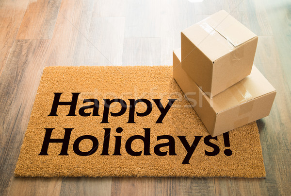 Happy Holidays Welcome Mat On Wood Floor With Shipment of Boxes Stock photo © feverpitch