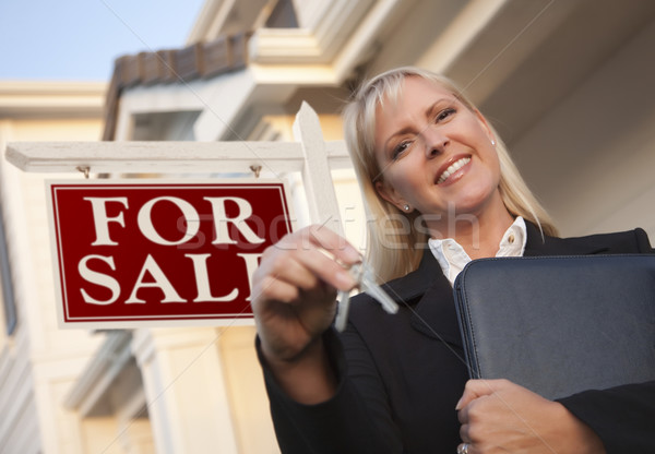 Real Estate Agent with Keys in Front of Sign and House Stock photo © feverpitch
