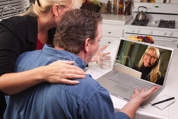 Couple In Kitchen Using Laptop - Customer Support Stock photo © feverpitch