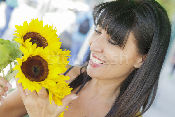 Pretty Italian Woman Looking at Sunflowers at Market Stock photo © feverpitch