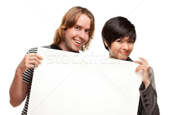 Attractive Diverse Couple Holding Blank White Sign Stock photo © feverpitch