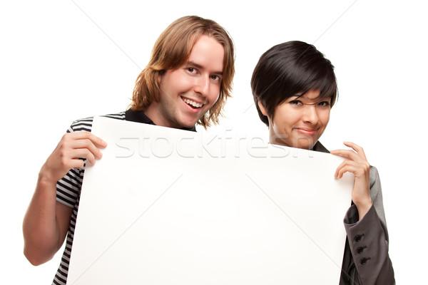 Atrakcyjny różnorodny para biały podpisania Zdjęcia stock © feverpitch