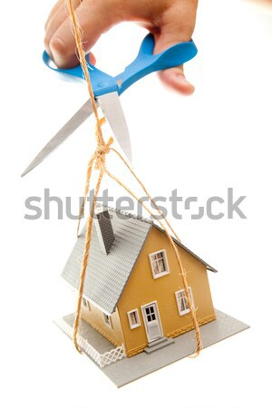 Hand with Scissors Cutting String Holding House  Stock photo © feverpitch