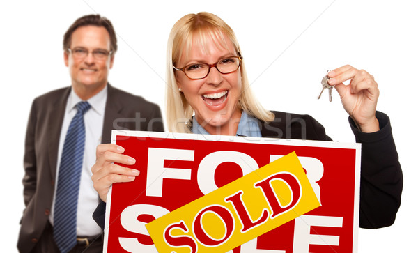 Man with Blonde Woman Holding Keys and Sold For Sale Sign Stock photo © feverpitch