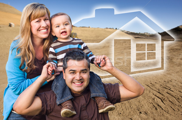 Mixed Race Family at Construction Site with Ghosted House Behind Stock photo © feverpitch
