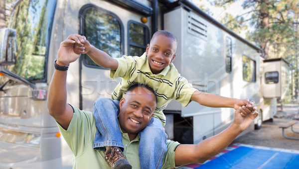 Happy African American Father and Son In Front of Their Beautifu Stock photo © feverpitch