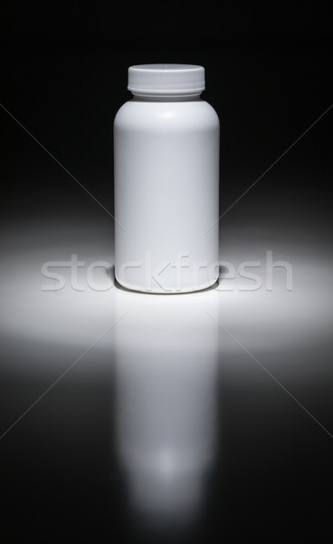Blank White Bottle Ready For Your Text Under Spot Light. Stock photo © feverpitch