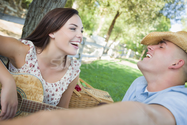 Mixed Race Couple with Guitar and Cowboy Hat in Park Stock photo © feverpitch