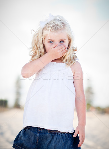 Adorable Blue Eyed Girl Covering Her Mouth Stock photo © feverpitch