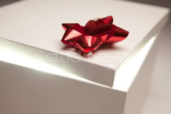 Red Bow Gift Box Lid Showing Very Bright Contents Stock photo © feverpitch