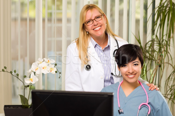 Stock photo: Smiling Mixed Race Female Doctors or Nurses in Office Setting