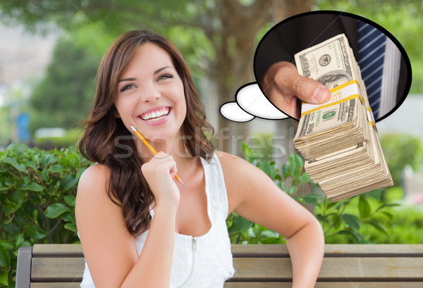 Thoughtful Young Woman with Hand Holding Stack of Money Inside T Stock photo © feverpitch