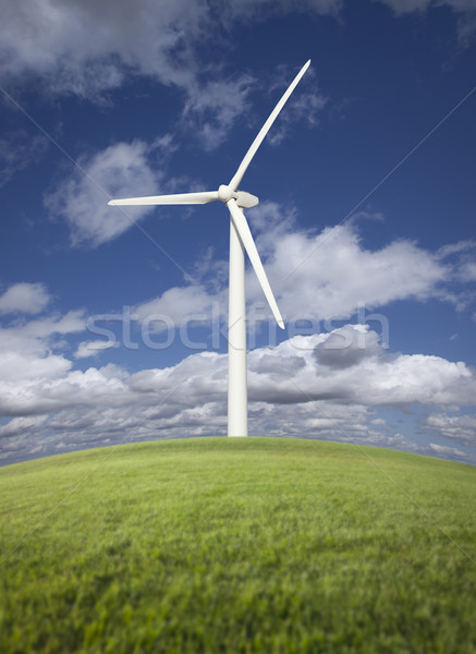 Wind Turbine Over Grass Field, Dramatic Sky and Clouds Stock photo © feverpitch